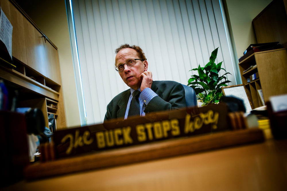 "Warren (outside Detroit) - Mayor James R. Fouts at his desk where he keeps President Truman's famous quote ""The buck stops here"". Photographer: Chris Maluszynski /MOMENT"