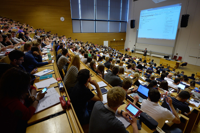 FRANKFURT AM MAIN, GERMANY - OCTOBER 13: Students follow a commercial information technology in a lecture hall of the Johann Wolfang Goethe-University on October 13, 2014 in Frankfurt am Main, Germany. The Johann Wolfgang Goethe-University celebrates its 100th anniversary with a ceremony on 18 October. (Photo by Thomas Lohnes/Getty Images)